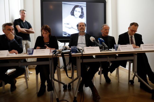 Researchers speak in front of a screen displaying a picture of Anne Frank as the Anne Frank House publishes unknown text of the young Jew who hid from the Nazis with her family in the Dutch capital, on May 15, 2018 in Amsterdam. - Two pages from her world-famous diary have been made visible with digital photo-editing techniques. (Photo by - / ANP / AFP) / Netherlands OUT        (Photo credit should read -/AFP/Getty Images)