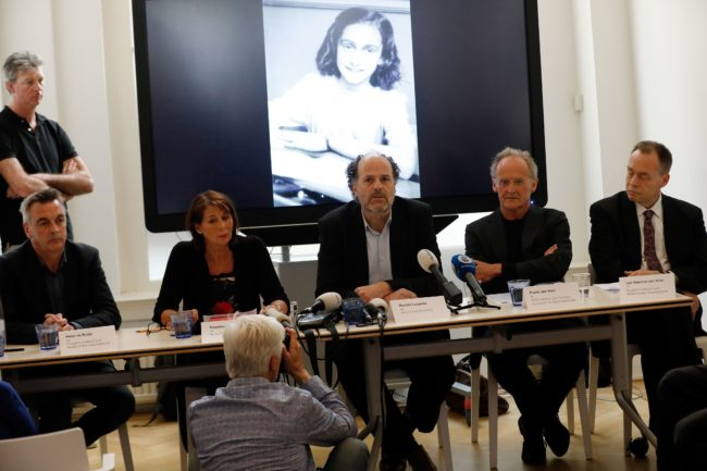 Ronald Leopold (C), executive director of the Anne Frank House, speaks during a press conference to present two unknown pages of Anne Frank's diary, on May 15, 2018 in Amsterdam. - Two pages of Anne Frank's world-famous diary - which she covered over with brown paper, discovering dirty jokes and a teenager's interest in sex - have been made visible with digital photo-editing techniques. (Photo by Bas CZERWINSKI / ANP / AFP) / Netherlands OUT        (Photo credit should read BAS CZERWINSKI/AFP/Getty Images)