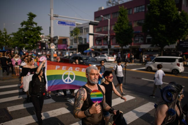 In a photo taken on May 26, 2018 participants of the 'Seoul Drag Parade' march in the Itaewon district of Seoul. - South Korea held its first ever drag parade this weekend, a small but significant step for rights activists in a country that remains deeply conservative when it comes to gender and sexuality. (Photo by Ed JONES / AFP)        (Photo credit should read ED JONES/AFP/Getty Images)