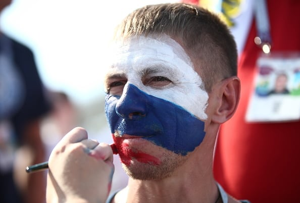 SAMARA, RUSSIA - JUNE 25, 2018: A fan of Team Russia has his face painted with the colours of the Russian flag outside Samara Arena ahead of a 2018 FIFA World Cup Group A football match between Russia and Uruguay. Valery Sharifulin/TASS (Photo by Valery SharifulinTASS via Getty Images)