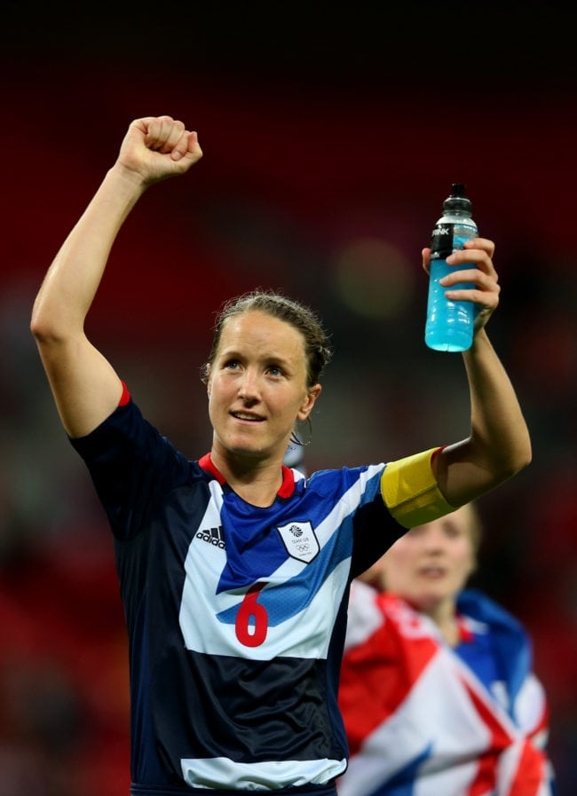 LONDON, ENGLAND - JULY 31:  Casey Stoney #6 of Great Britain waves to the crowd draped in a Union Jack as she celebrates her team's victory after the Women's Football first round Group E Match between Great Britain and Brazil on Day 4 of the London 2012 Olympic Games at Wembley Stadium on July 31, 2012 in London, England.  (Photo by Julian Finney/Getty Images)