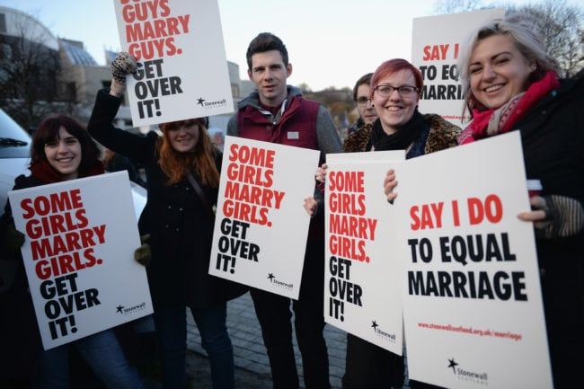EDINBURGH, SCOTLAND - NOVEMBER 20:  Campaigners from the Stonewall Equality Network hold a rally outside the Scottish Parliament on November 20, 2013 in Edinburgh, Scotland. Members of the Scottish Parliament will vote later today on the Marriage and Civil Partnership Bill, debating on general principles of controversial Scottish Government proposals to allow gay couples to wed.  (Photo by Jeff J Mitchell/Getty Images)