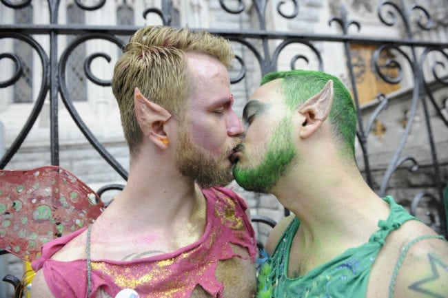DUBLIN, IRELAND - JUNE 27: A couple kiss as they take part in the annual Gay Pride Parade on June 27, 2015 in Dublin, Ireland. Gay marriage was declared legal across the US in a historic supreme court ruling. Same-sex marriages are now legal across the entirety of the United States.