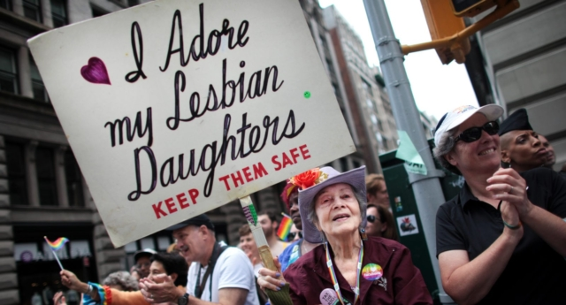 Frances Goldin, who has two lesbian daughters, holds a sign while watching the Gay Pride Parade (Yana Paskova/Getty Images)