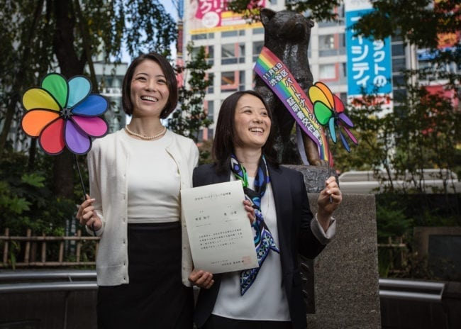 TOKYO, JAPAN - NOVEMBER 05:  Japanese couple Koyuki Higashi (L) and Hiroko Masuhara (R) celebrate as hold up their same-sex marriage certificate in front of Shibuya's Hachiko statue on November 5, 2015 in Tokyo, Japan. Shibuya Ward in the Tokyo became the first local government in Japan to issue the official certificates recognizing same-sex partnerships.  (Photo by Christopher Jue/Getty Images)