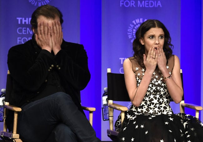 """HOLLYWOOD, CA - MARCH 25:  David Harbour and Millie Bobby Brown speak onstage at The Paley Center For Media's 35th Annual PaleyFest Los Angeles - """"Stranger Things"""" at Dolby Theatre on March 25, 2018 in Hollywood, California.  (Photo by Frazer Harrison/Getty Images)"""