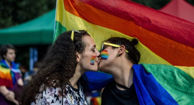 A couple kisses during Pride (DIMITAR DILKOFF/AFP/Getty)