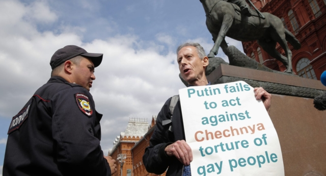 British gay rights activist Peter Tatchell stages an anti-Putin protest against the mistreatment of LGBT people in Russia in front of a monument to Soviet Marshal Georgy Zhukov on Manezhnaya Square in Moscow on June 14, 2018. (MAXIM ZMEYEV/AFP/Getty)