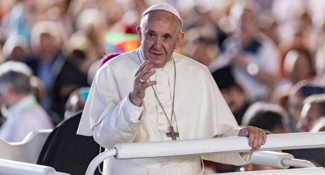 Pope Francis greets a crowd in Geneva (MARTIAL TREZZINI/AFP/Getty)