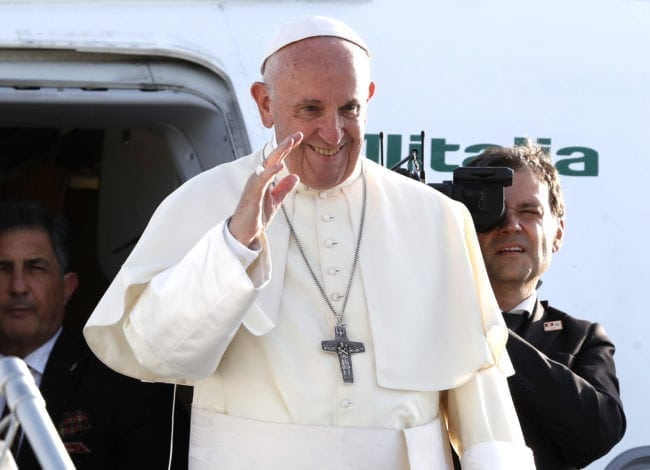 Pope Francis waves as he leaves at Cointrin airport in Geneva, on June 21 2018 after a one-day visit at the invitation of the World Council of Churches (WWC). - Pope Francis visited the World Council of Churches on 21 June as centrepiece of the ecumenical commemoration of the WCC's 70th anniversary. (Photo by DENIS BALIBOUSE / POOL / AFP)        (Photo credit should read DENIS BALIBOUSE/AFP/Getty Images)