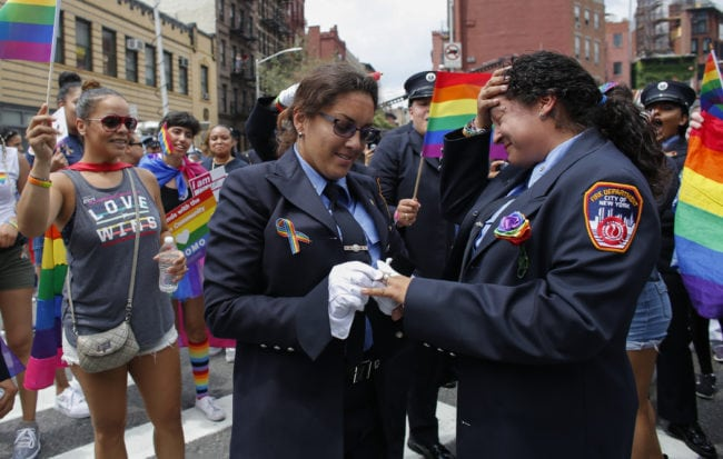 NEW YORK, NY - JUNE 24:  EMT Trudy Bermudez and paramedic Tayreen Bonilla of New York City Fire Department get engaged at the annual Pride Parade on June 24, 2018 in New York City. The first gay pride parade in the U.S. was held in Central Park on June 28, 1970.  (Photo by Kena Betancur/Getty Images)
