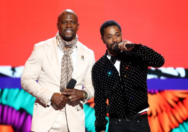 LOS ANGELES, CA - JUNE 24:  Terry Crews (L) and Lakeith Stanfield speak onstage at the 2018 BET Awards at Microsoft Theater on June 24, 2018 in Los Angeles, California.  (Photo by Frederick M. Brown/Getty Images for BET)