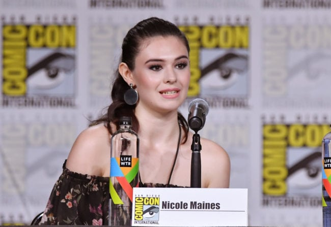 Nicole Maines walks onstage at the Supergirl Q&A during Comic Con