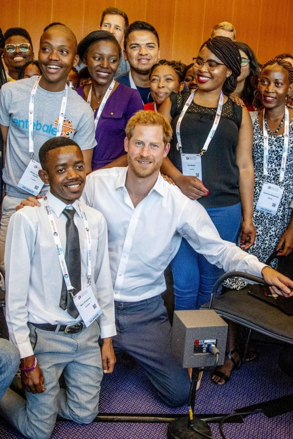 """British Prince Harry (C) poses for a picture prior to the Aids2018 conference in the Rai, in Amsterdam on July 23, 2018. - From 23 to July 27, thousands of delegates -- researchers, campaigners, activists and people living with the killer virus -- will attend the 22nd International AIDS Conference amid warnings that """"dangerous complacency"""" may cause an unstoppable resurgence. (Photo by Robin UTRECHT / ANP / AFP) / Netherlands OUT        (Photo credit should read ROBIN UTRECHT/AFP/Getty Images)"""