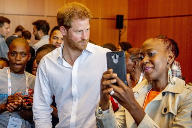 """British Prince Harry (C) attends the Aids2018 conference in the Rai, in Amsterdam on July 23, 2018. - From 23 to July 27, thousands of delegates -- researchers, campaigners, activists and people living with the killer virus -- will attend the 22nd International AIDS Conference amid warnings that """"dangerous complacency"""" may cause an unstoppable resurgence. (Photo by Robin UTRECHT / ANP / AFP) / Netherlands OUT        (Photo credit should read ROBIN UTRECHT/AFP/Getty Images)"""