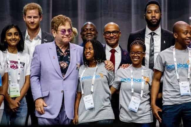 """British Prince Harry (2ndL) and sir Elton John (3rdL) pose for a picture during a session about the Elton John Aids Fund on the second day of the Aids2018 conference, in Amsterdam on July 24, 2018. - From 23 to July 27, thousands of delegates -- researchers, campaigners, activists and people living with the killer virus -- attend the 22nd International AIDS Conference amid warnings that """"dangerous complacency"""" may cause an unstoppable resurgence. (Photo by Robin Utrecht / ANP / AFP) / Netherlands OUT        (Photo credit should read ROBIN UTRECHT/AFP/Getty Images)"""