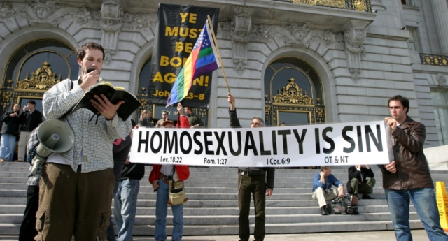 Anti-gay protesters quote from Leviticus to oppose LGBT rights (Deborah Coleman/Getty)