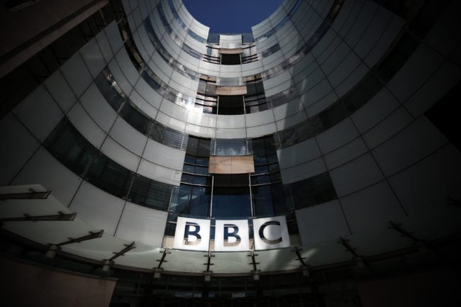 LONDON, ENGLAND - JULY 25: The logo for the Broadcasting House, the headquarters of the BBC is displayed outside on July 25, 2015 in London, England. The main Art Deco-style building of the British Broadcasting Corporation was officially opened on 15 May 1932 and has since seen extensive refurbishment with an extension to the main building completed in 2005.