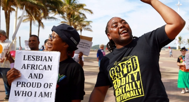 Gay rights activists participate in a demonstration rally marking the International Day Against Homophobia and Transphobia (IDAHOT) at the North Beach in Durban, on May 17, 2014 (Photo by Rajesh Jantilal/AFP/Getty Images)
