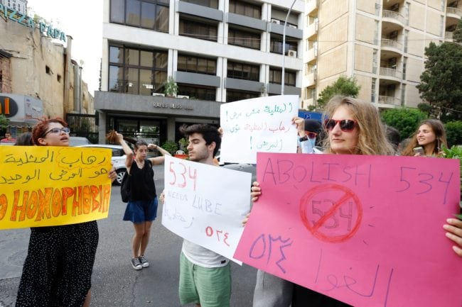 """Activists from of the Lebanese LGBT community take part in a protest outside the Hbeish police station in Beirut on May 15, 2016, demanding the release of four transsexual women and calling for the abolishment of article 534 of the Lebanese Penal code, which prohibits having sexual relations that """"contradict the laws of nature"""". / AFP / ANWAR AMRO (Photo credit should read ANWAR AMRO/AFP/Getty Images)"""