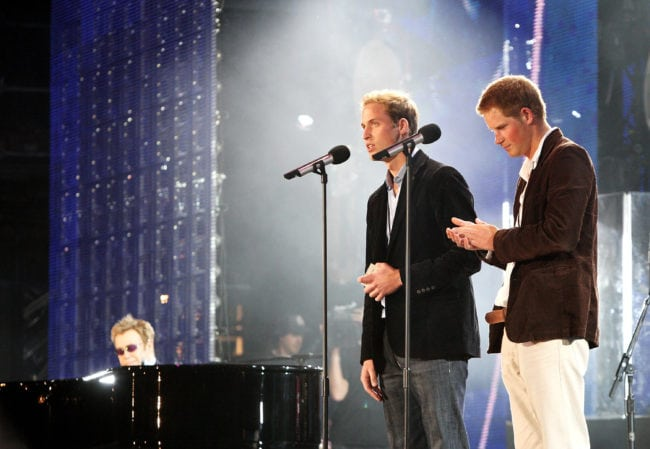 LONDON - JULY 01:  Their Royal Highnesses Prince William (L) and Prince Harry (R) speak on stage with Sir Elton John (far L) at the piano at the Concert for Diana at Wembley Stadium on July 1, 2007 in London, England. The Concert falls on the date that would have been the late Princess's 46th birthday and marks 10 years since her death with an event headed by Princes William and Harry to celebrate her life.  (Photo by Getty Images/Getty Images)