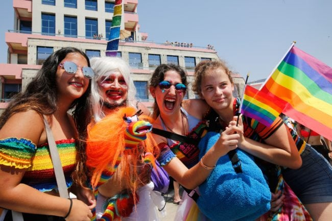 Revellers celebrate along a sea side avenue in Tel Aviv during the Israeli city's annual Gay Pride parade on June 8, 2018. - Tens of thousands of people gathered along the beach in the Israeli commercial capital Tel Aviv for the largest Gay Pride event in the Middle East. (Photo by GIL COHEN-MAGEN / AFP)        (Photo credit should read GIL COHEN-MAGEN/AFP/Getty Images)