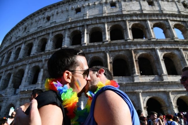 Revellers pose in front of the Coliseum during the Gay Pride Parade in Rome on June 9, 2018. (Photo by Vincenzo PINTO / AFP) (Photo credit should read VINCENZO PINTO/AFP/Getty Images)