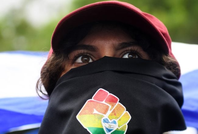 A person joins thousands of Nicaraguan anti-government protesters, including members of the Lesbian, Gay, Bisexual, Transgender/Transsexual and Intersexed (LGBTI) movement, in an national LGBTI march for Justice and Democracy, in Managua on June 28, 2018. - Nicaraguan human rights groups expressed renewed concern earlier this week over a rising death toll from months of protests against the government of President Daniel Ortega. (Photo by Marvin RECINOS / AFP)        (Photo credit should read MARVIN RECINOS/AFP/Getty Images)