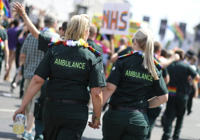LONDON, ENGLAND - JULY 07: Ambulance Services march along Piccadilly Circus during Pride In London on July 7, 2018 in London, England. It is estimated over 1 million people will take to the streets and approximately 30,000 people and 472 organisations will join the annual parade, which is one of the world's biggest LGBT+ celebrations.