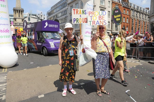 LONDON, ENGLAND - JULY 07: Barefoot Wine are the official wine sponsor of Pride In London and have been a proud ally of the LGBTQ community since 1988. They celebrated in this years parade with 6 dancing wine bottles matching the 6 different colours of the pride rainbow on July 7, 2018 in London, England.