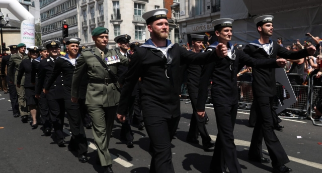 Royal Navy sailors and Royal Marines show their support for the LGBT+ community by marching at Pride in London (Lphot Joe Cater/Sam Seeley)