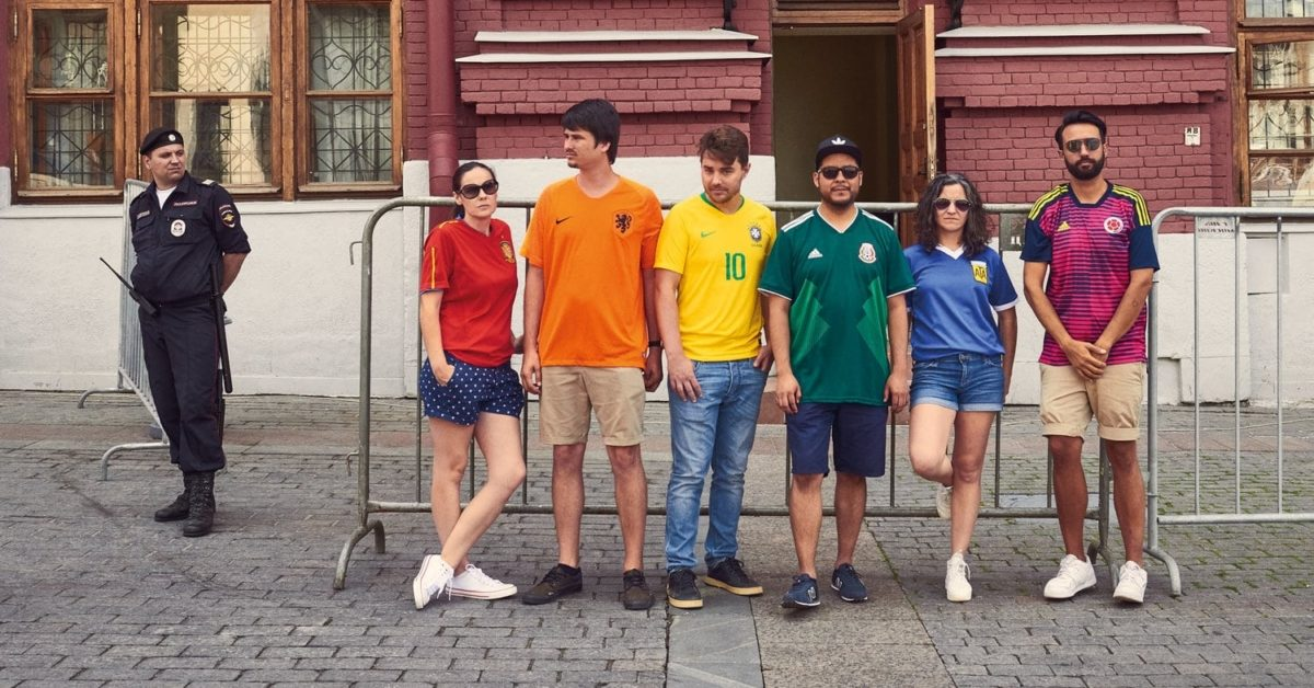 The six activists pose with their respective national team's football jerseys to form the rainbow flag (Image by The Hidden Flag/TheHiddenFlag.org)