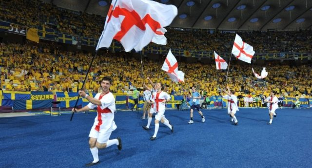 People wave the English flag before the Euro 2012 championships football match Sweden vs England on June 15, 2012 at the Olympic Stadium in Kiev (Photo by Genya Savilova/AFP/GettyImages)