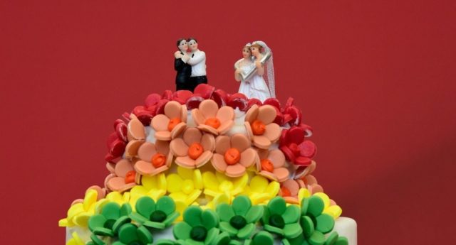 A wedding cake in rainbow colors and decorated with figurines of two women and two men is pictured in Berlin on June 30, 2017 (Photo by Tobias Schwarz/AFP/Getty Images)