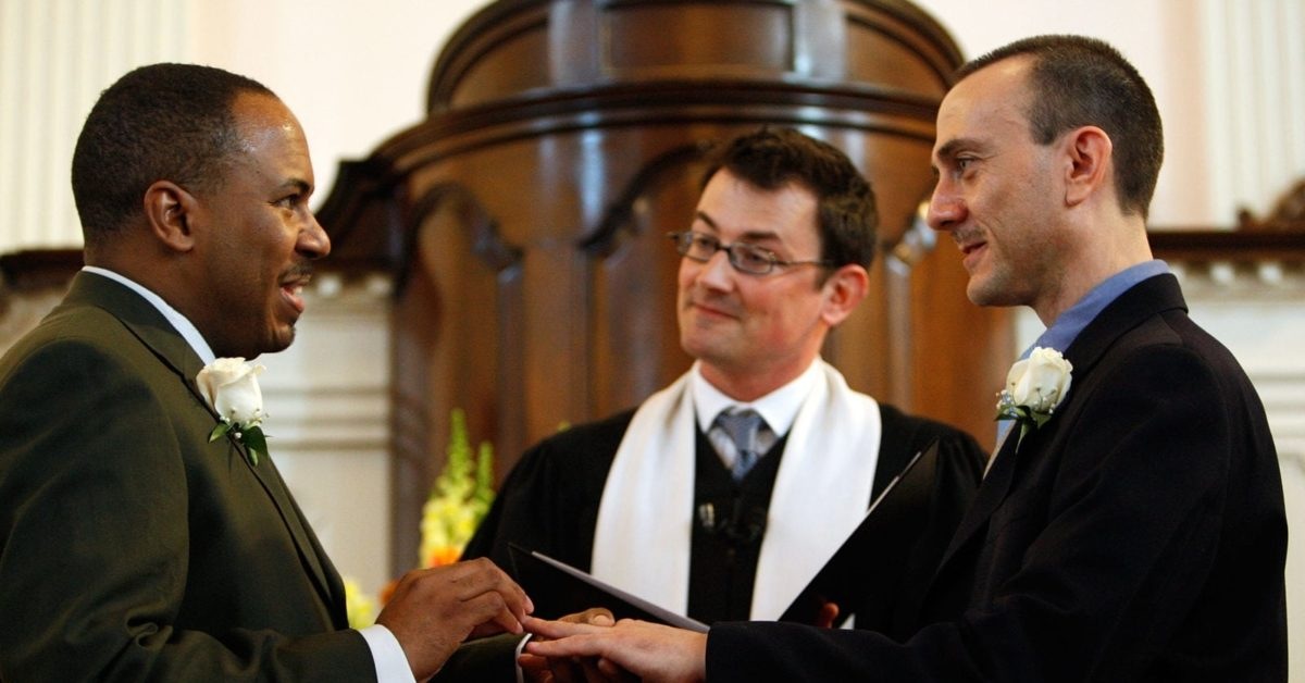 Rick Imirowicz (R) and Terrance Health (L) exchange rings as Rev. Robert Hardies officiates during their wedding at All Souls Unitarian Church on the first day same-sex couples are legal to wed under a new law March 9, 2010 in Washington, DC (Photo by Alex Wong/Getty Images)