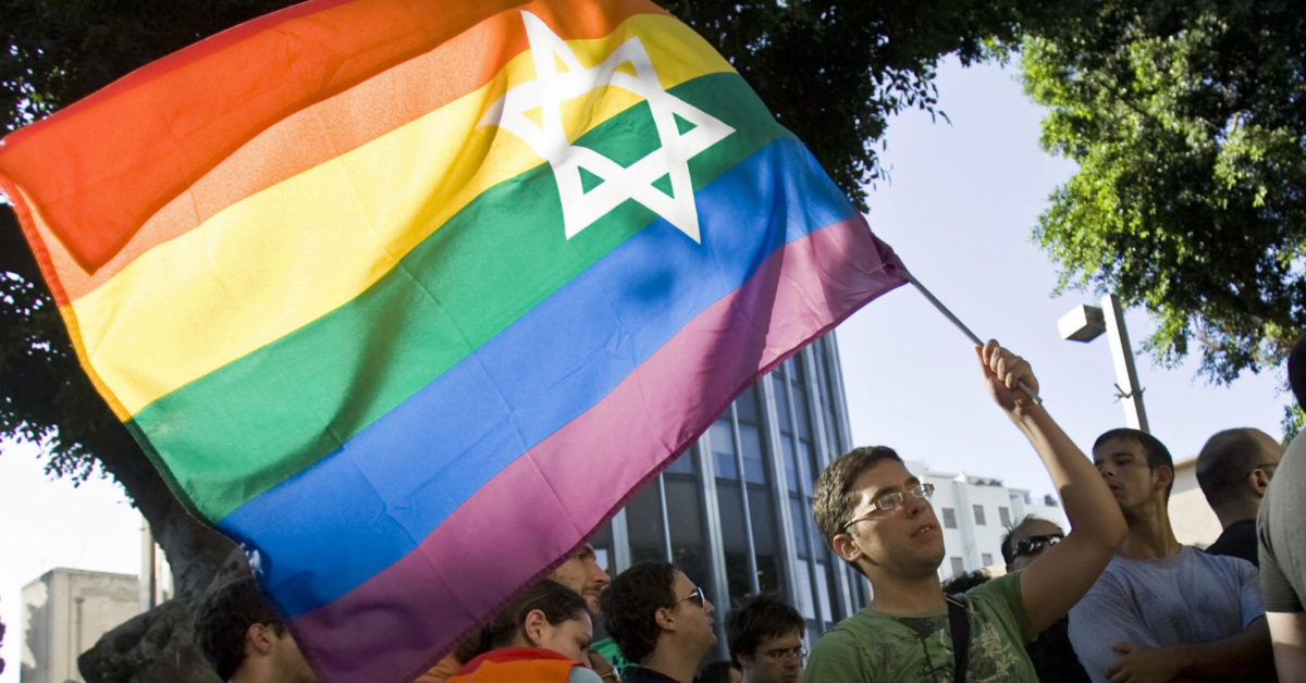 An Israeli man waves a rainbow flag bearing the Star of David during a demonstration (Jonathan Nackstrand/AFP/Getty)