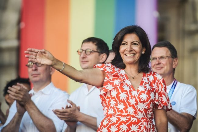 Paris mayor Anne Hidalgo waves as she arrives on stage to deliver a speech during the inauguration of the sport village of the 2018 Gay Games' edition, on the Parvis de l'Hotel de Ville, in Paris, on August 4, 2018, on the sidelines of the opening of the Gay Games. - French capital, Paris, hosts the Gay Games from August 4, 2018 to August 12, 2018 bringing together participants from around the world for a week of sport and culture in a carnival atmosphere. Paris will welcome more than 10,000 participants from 90 countries around the world, including some where homosexuality is illegal or repressed. (Photo by Lucas Barioulet / AFP)        (Photo credit should read LUCAS BARIOULET/AFP/Getty Images)
