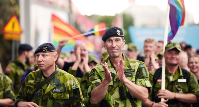 General Micael Byden, Supreme Commander of the Swedish Armed Forces applauds as he and his troops take part in the Europride Parade in Stockholm, Sweden, on August 4, 2018. (HOSSEIN SALMANZADEH/AFP/Getty)