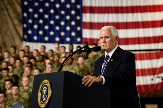 US Vice President Mike Pence introduces US President Donald Trump during a signing ceremony ceremony for the John S. McCain National Defense Authorization Act for Fiscal Year 2019 at Fort Drum, New York, on August 13, 2018. (Photo by Brendan Smialowski / AFP)        (Photo credit should read BRENDAN SMIALOWSKI/AFP/Getty Images)