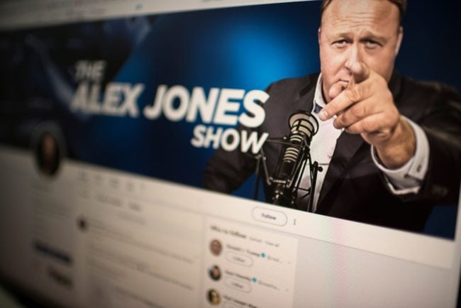 Picture showing a computer screen displaying the Twitter account of far-right conspiracy theorist Alex Jones (ERIC BARADAT/AFP/Getty Images)