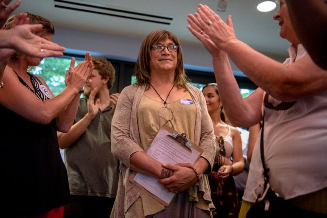 BURLINGTON, VT - AUGUST 15: Vermont Democratic gubernatorial nominee Christine Hallquis listens to speakers at a Vermont Democratic Unity Rally on August 15, 2018 in Burlington, Vermont. Hallquist, the first openly transgender person to win a major party nomination for governor, will face off against Republican incumbent Governor Phil Scott in this year's general election. (Photo by Hillary Swift/Getty Images)