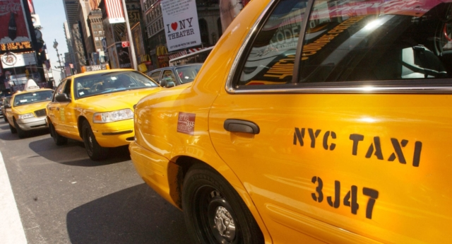 New York City taxis wait for passengers in Times Square (Spencer Platt/Getty)