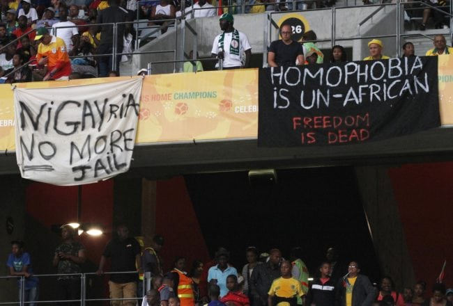 CAPE TOWN, SOUTH AFRICA - JANUARY 19: Banners in protest at the Anti-Gay Marrage Law recently passed in Nigeria are displayed in the crowd during the 2014 African Nations Championship match between South Africa and Nigeria at Cape Town Stadium on January 19, 2014 in Cape Town, South Africa. (Photo by Shaun Roy/Gallo Images/Getty Images)