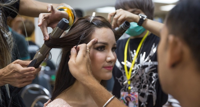 A transgender beauty contestant has make up applied and her hair done before a competition on May 8, 2015 in Pattaya, Thailand (Taylor Weidman/Getty)