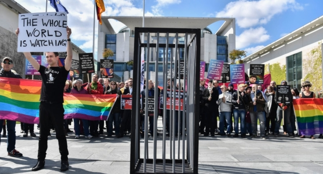 A protest in Berlin calling on Russian President to put an end to the persecution of gay men in Chechnya. (JOHN MACDOUGALL/AFP/Getty)