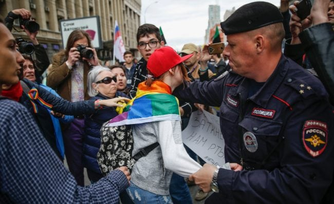 Policemen detain a LGBT activist during a protest in Moscow on August 26, 2017. Nearly 1,000 Russians protested during a demonstration against the intensification of surveillance and restrictions on the Internet, marked by at least eight arrests. / AFP PHOTO / Maxim ZMEYEV (Photo credit should read MAXIM ZMEYEV/AFP/Getty Images)