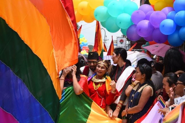 This photo taken on August 8, 2017 shows Nepali transgender person Monika Shahi Nath taking part in a gay pride parade in Kathmandu. Monika Shahi Nath, 40, became Nepal's first transgender person to be issued with a marriage certificate by district officials when she married 22-year-old Ramesh Nath Yogi in May, even though Nepal has no formal laws for such unions. The couple have found a rare acceptance in Nepal, where many transgender people still struggle to be open about their identity despite progressive laws that include a third gender option on identity cards and passports. / AFP PHOTO / Prakash MATHEMA / TO GO WITH Nepal-transgender-marriage-rights (Photo credit should read PRAKASH MATHEMA/AFP/Getty Images)