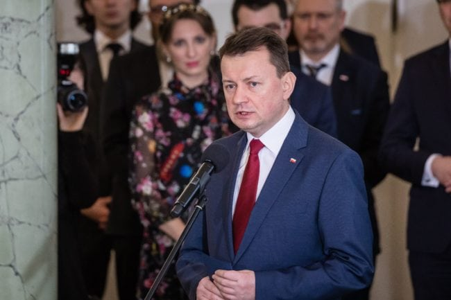 Newly-appointed Defence Minister Minister Mariusz Blaszczak on January 9, 2018 speaks during a ceremony at the presidential palace in Warsaw, following a sweeping reshuffle of the government.  Poland's new rightwing Prime Minister Mateusz Morawiecki has sacked his defence and foreign ministers in a major cabinet reshuffle that comes just over a month after his own appointment. Controversial defence minister Antoni Macierewicz and foreign minister Witold Waszczykowski lost their jobs along with environment minister Jan Szyszko among others as Morawiecki seeks to mend ties with Poland's EU partners strained since his Law and Justice (PiS) party took office in 2015. / AFP PHOTO / Wojtek RADWANSKI / The erroneous mention[s] appearing in the metadata of this photo by Wojtek RADWANSKI has been modified in AFP systems in the following manner: [Mariusz Blaszczak ] instead of [Jacek Czaputowicz]. Please immediately remove the erroneous mention[s] from all your online services and delete it (them) from your servers. If you have been authorized by AFP to distribute it (them) to third parties, please ensure that the same actions are carried out by them. Failure to promptly comply with these instructions will entail liability on your part for any continued or post notification usage. Therefore we thank you very much for all your attention and prompt action. We are sorry for the inconvenience this notification may cause and remain at your disposal for any further information you may require.        (Photo credit should read WOJTEK RADWANSKI/AFP/Getty Images)