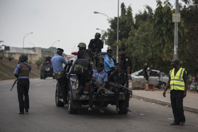 Members of the Nigerian police pursue protesters from the Islamic Movement of Nigeria (IMN) in Abuja on April 17, 2018. Nigerian police fired teargas for a second day on April 17 at protesters demanding the release of Shiite leader Ibrahim Zakzaky, who has been in jail without charge since December 2015. / AFP PHOTO / STEFAN HEUNIS (Photo credit should read STEFAN HEUNIS/AFP/Getty Images)