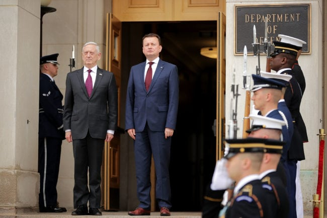 ARLINGTON, VA - APRIL 27:  U.S. Defense Secretary James Mattis (L) hosts Polish Defense Minister Mariusz Blaszczak for an Enhanced Honor Cordon at the Pentagon River Entrance April 27, 2018 in Arlington, Virginia. Poland recently signed a $4.75 billion arms deal - its biggest in history - with the United States and agreed to buy the Patriot missile defense system. Mattis praised the deal as a step forward in modernizing the Polish military.  (Photo by Chip Somodevilla/Getty Images)